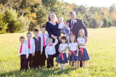 October 2016 Our daughter's wedding - I made my granddaughters skirts, embroidered tops and ties for the grandsons. Oh and that hint of coral is a vest I made my husband.