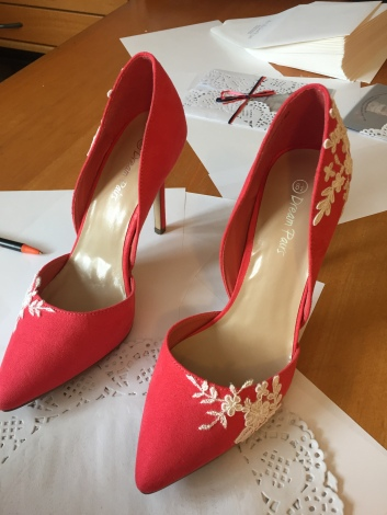 My daughter's customized shoes for the wedding - we added some lace from the dress.