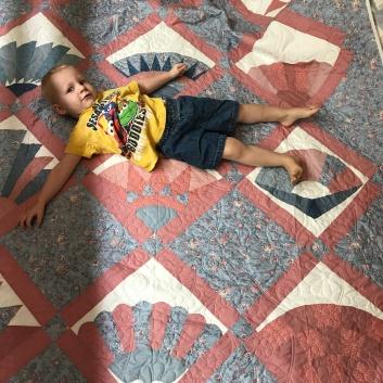Refugee quilt - I have a helper again.